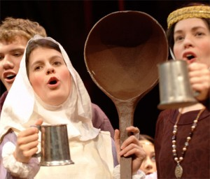 "Helen with a ""big spoon"" in the 2004 Christmas Revels"
