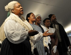 "The Washington Revels Jubilee Voices, including Andrea Blackford, left, sing ""Oh Freedom"" at the Frederick Douglass National Historical Site's 194th celebration of Douglass's birth. The event was held in a tent on the grounds of the historic Douglass home in Southeast Washington."
