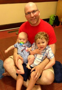 Patrick with his two boys at a music class.