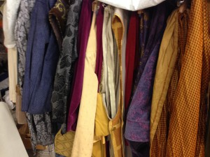 Costumes assembled on a rack in the Washington Revels shop