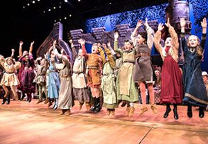 Children jumping in the Christmas Revels